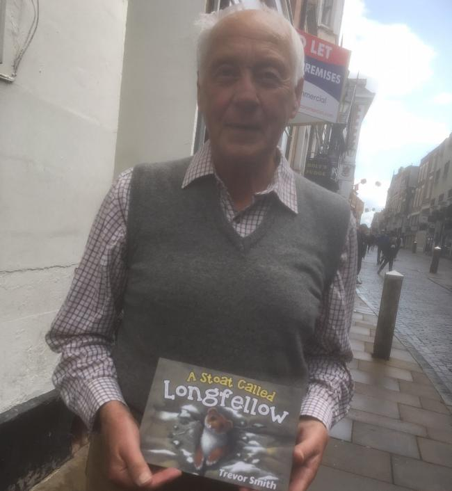 Trevor Smith, of Chester, with his book A Stoat Called Longfellow.