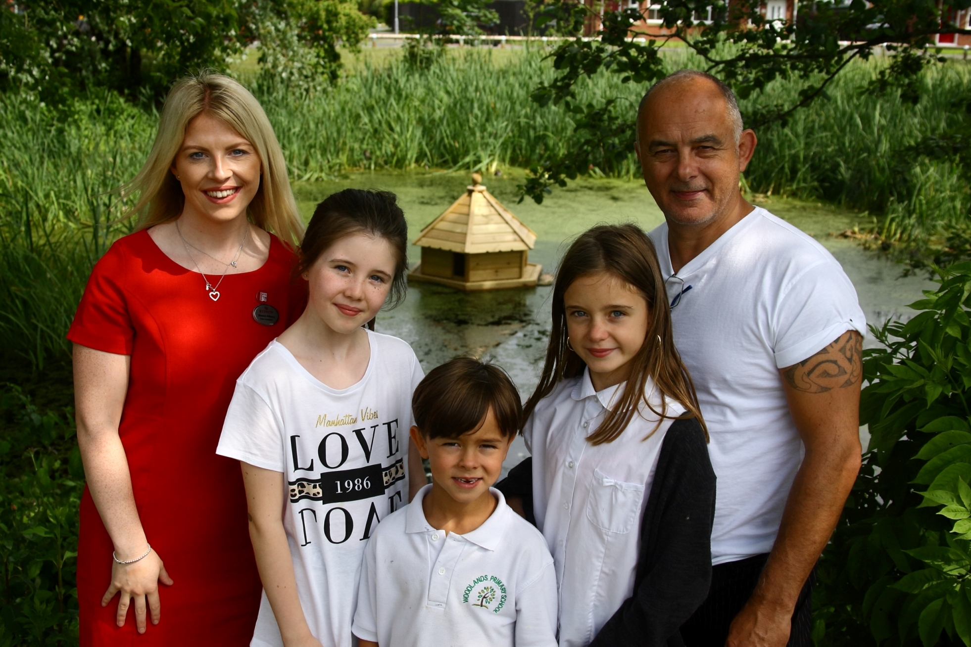 Great Sutton community pond group enjoys new duck house and bird feeder thanks to Redrow grant