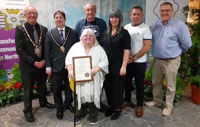 Representatives from Ellesmere Port in Bloom collect their award in Southport.