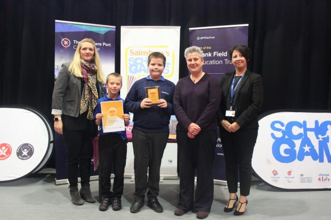 Westminster Community Primary headteacher Sue Finch, plus two of the school's Sports Ambassadors Daniel and Jake, receiving the Gold award.