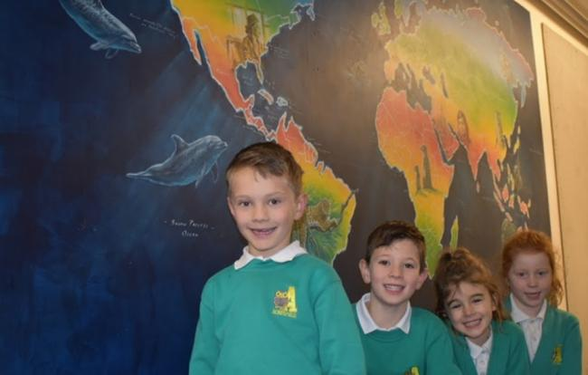 Acresfield Primary School pupils with the global mural.
