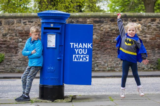 Photo issued by Royal Mail of a postbox in Edinburgh decorated in tribute to the NHS, one of five that have been installed in cities across the UK. Photo: Royal Mail/PA Wire