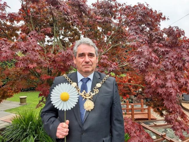 Lord Mayor of Chester Cllr Mark Williams with a metal daisy.
