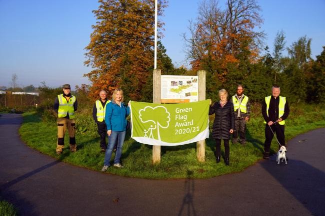 Friends of Countess of Chester Country Park celebrate the beauty spot's Green Flag award.