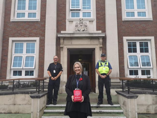 Sir Thomas Boteler Church of England High School Head Teacher Beverley Scott-Heron with a Bleeding Control Kit given to the school by Police Constable Ian Hampson, left, and PCSO Tony Spruce, right.