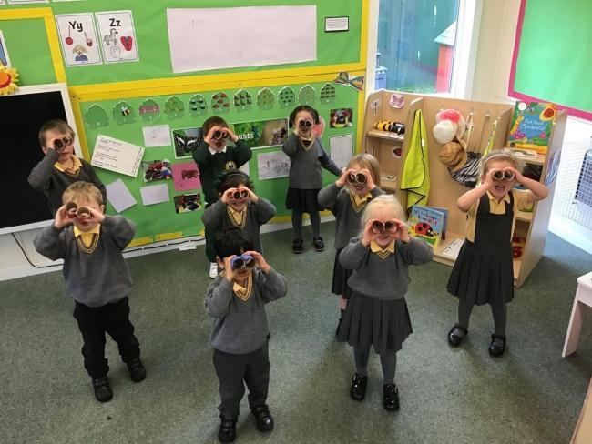 The Firs Prep School youngsters use their binoculars to look for mini beasts.