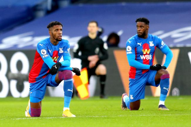 Wilfried Zaha takes the knee ahead of Crystal Palace's match with Sheffield United earlier this year