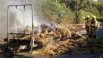 The fire involved 100 bales of hay.
