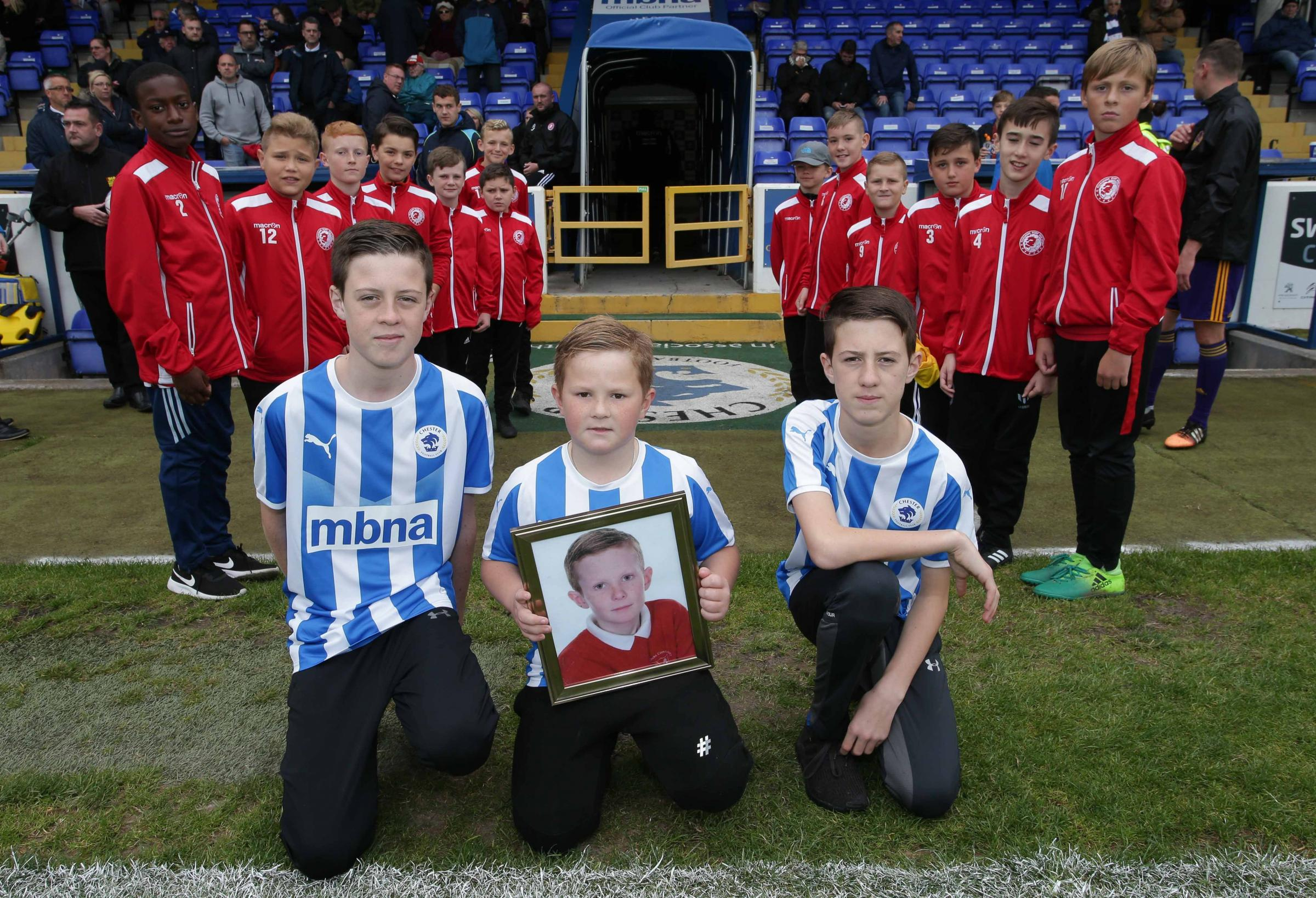 The tribute to Chester FC fan Cameron Rowley took place at the Swansway Chester Stadium on Saturday, September 22. With a picture of Cameron Rowley are Cameron's brothers Ben, Ethan and Jack. Pictures by Rick Matthews. RM220918l.