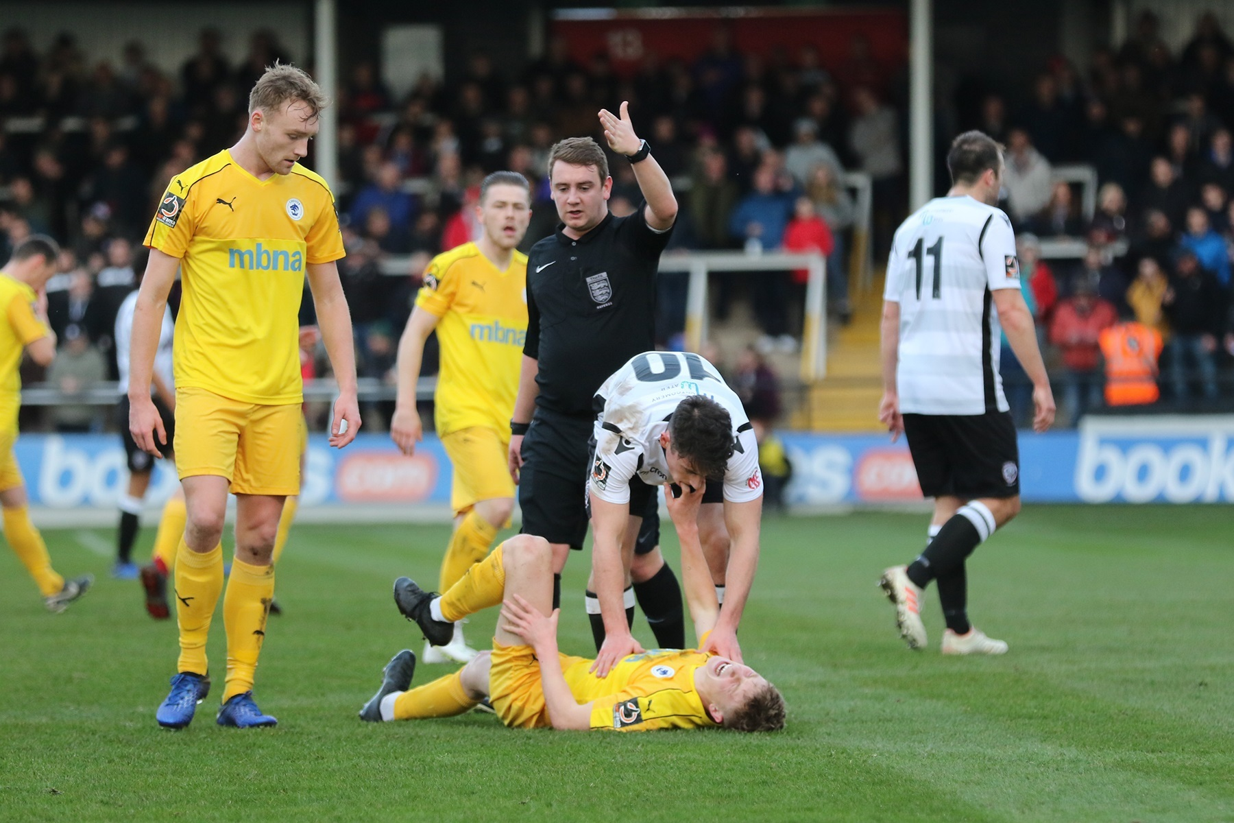 Matthew Thomson lies injured as Chester lose at Hereford (pic Steve Niblett)
