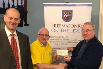 Freemasons Jeff Cunningham and Paul Massie thank the Team from Leighton Hospital by way of a donation.