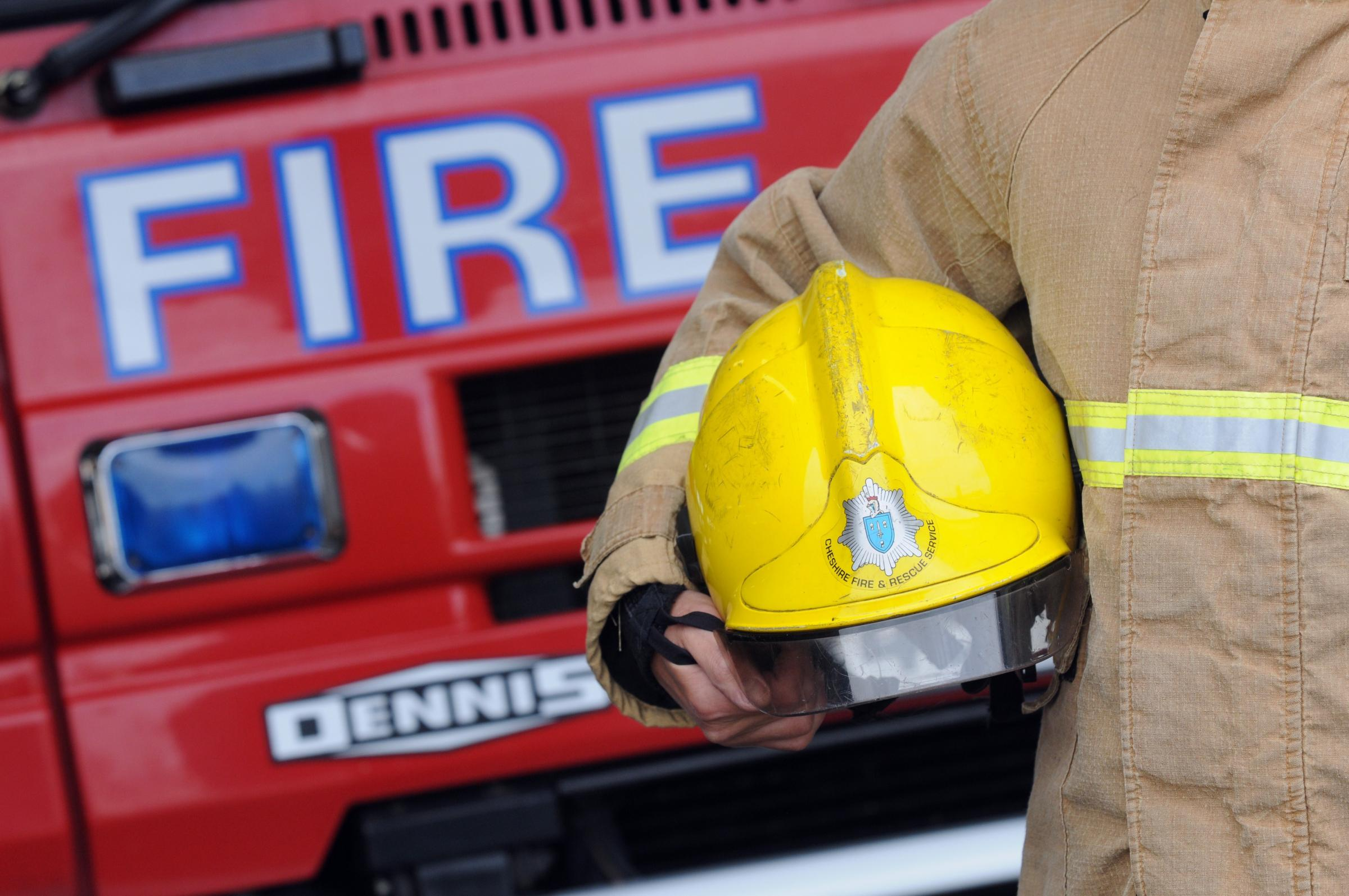 Two treated by paramedics following Ellesmere Port bedroom blaze
