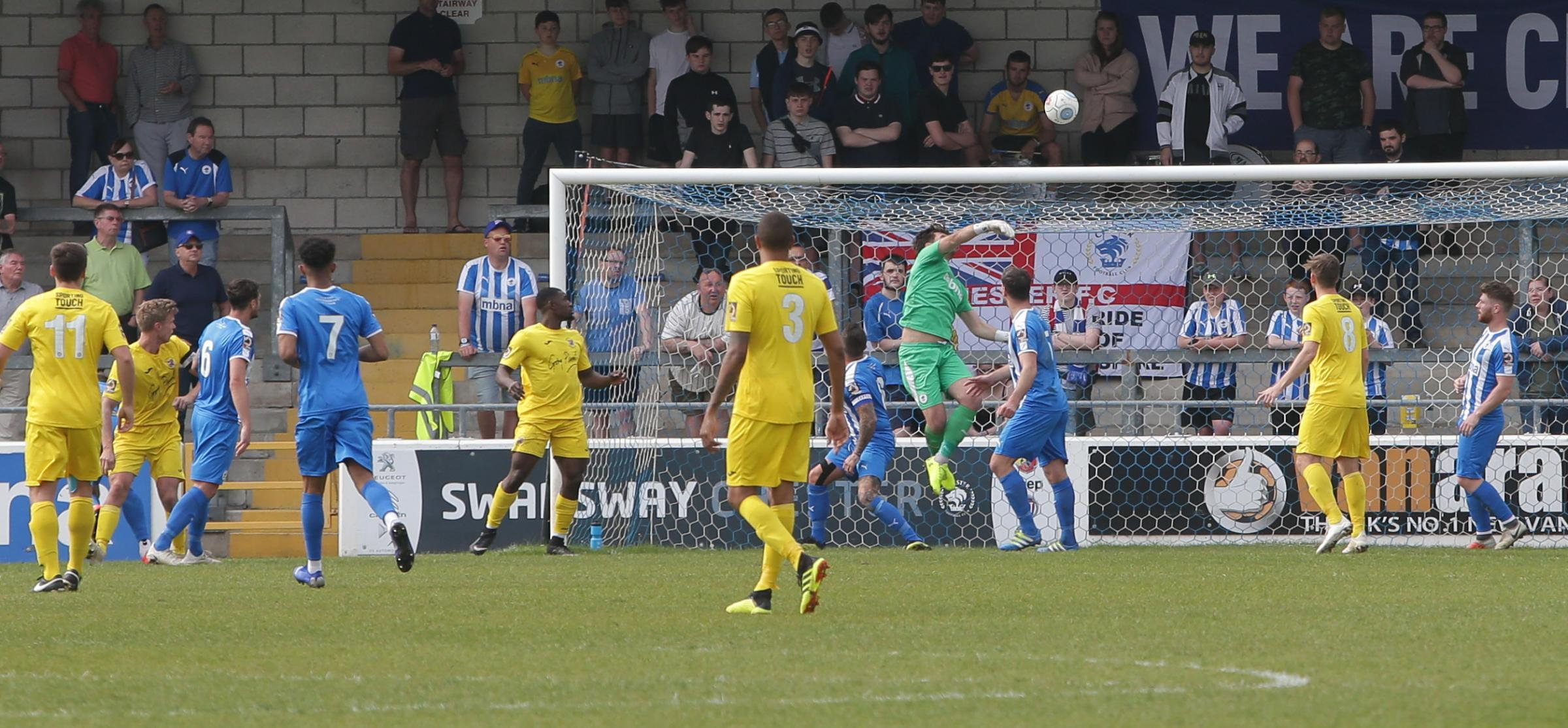 DOING HIS BIT: Chester stopper Grant Shenton makes a save against Brackley. Picture: RICK MATTHEWS
