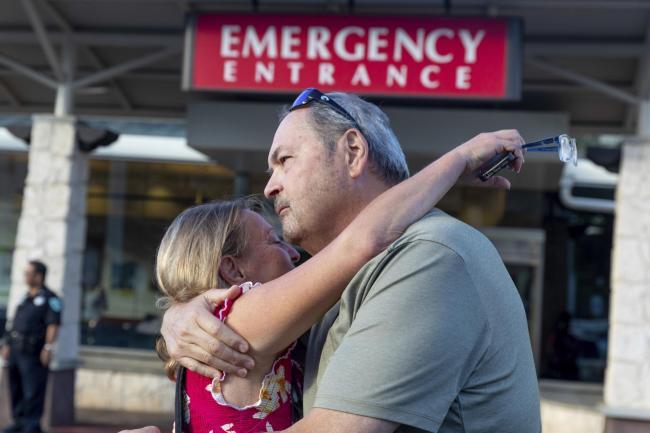 a61f0e6f Sarah Haynes embraces John Eller, father of Amanda Eller, outside a  hospital in Maui